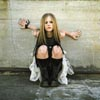 Avril Sitting Against a Wall